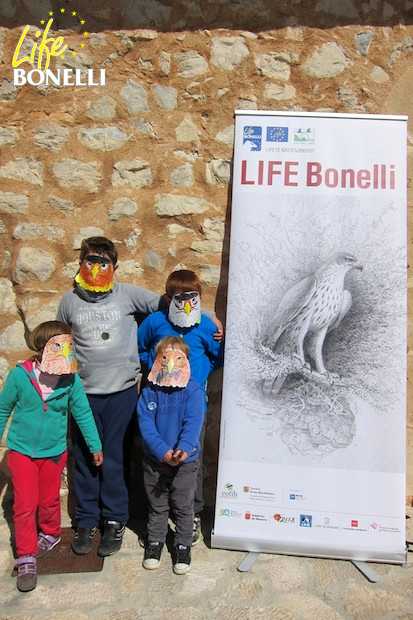 Children with Bonelli's Eagles masks which they had painted and shaped themselves on the Day of the Eagle.